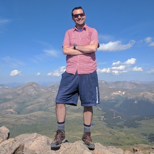 Devin Boyer at the summit of Mt. Beirstadt, CO